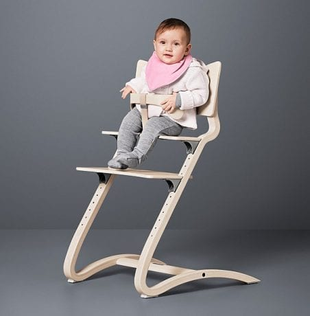 BAby girl sitting in wooden Leander High Chair