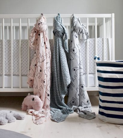 Done by Deer swaddles hanging on baby cot