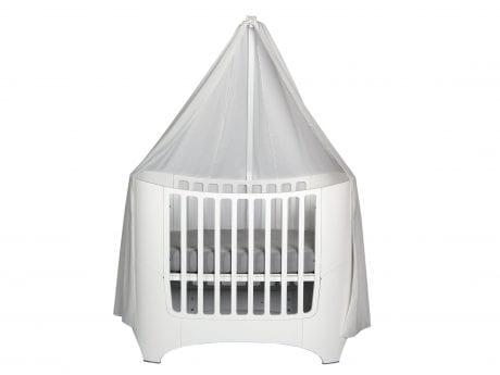 White Lenader baby cot with white canopy on the side