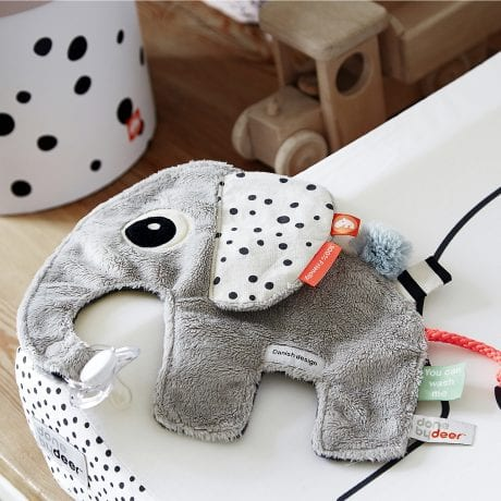 soft elephant baby comforter with spotty ears and texture tabs on change mat from Done by Deer